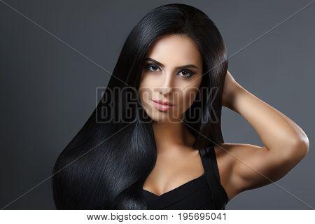 Beautiful Model Girl With Smooth Dark Hair. Perfect Hair. Black Dress