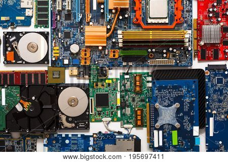 Computer microcircuits and hard drives disassembled closeup. Electronic parts of computer, background, top view