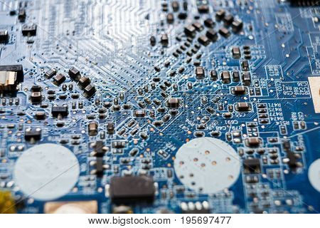 Laptop motherboard microcircuit closeup. Computer electronic parts background