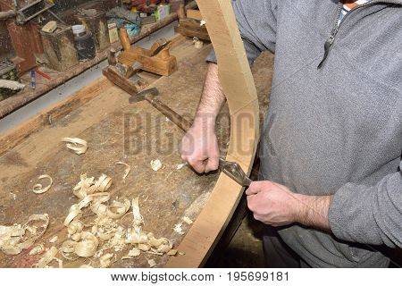 Carpenter Working With Plane On Wooden