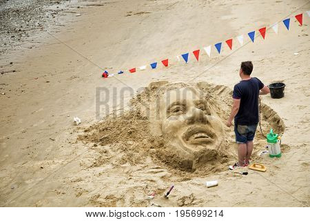 LONDON, UK - MAY 29, 2017:  Sand sculpture of Bob Marley on the Southbank Thames beach.  Sand sculpture is very popular during summer season on the Thames beach.