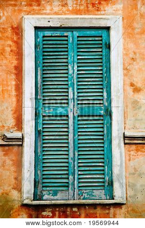 Old grungy window shutter from an old traditional Italian village