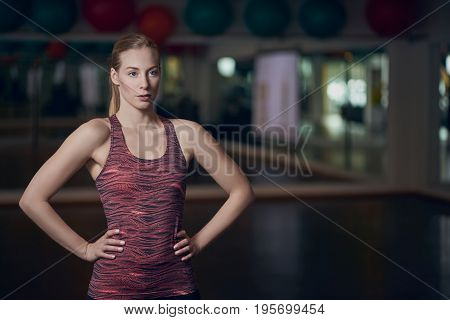Athletic Young Woman Posing In Gym