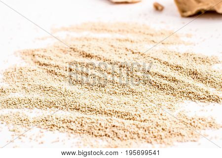 fresh and dried yeast isolated on white background