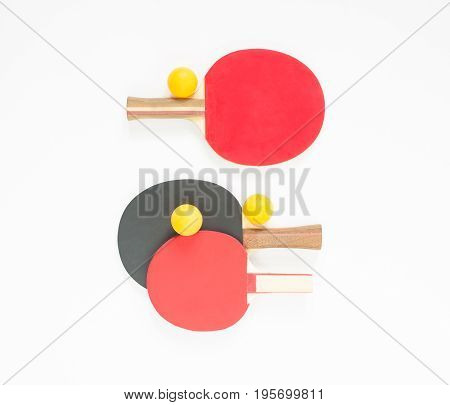 Sport background. Red and black ping-pong rackets and orange balls. Flat lay top view