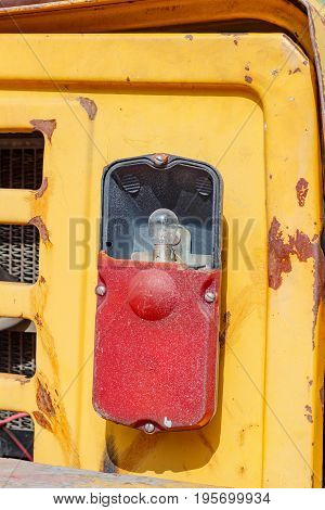 Damaged Taillight Of A Old Forklift Truck Closeup