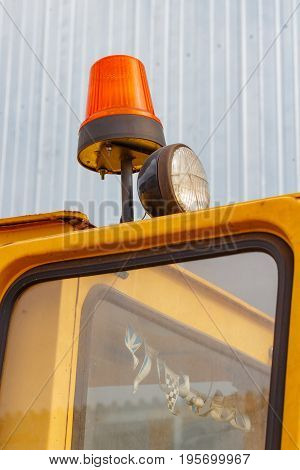 Orange Flashing Beacon On A Forklift Truck Closeup