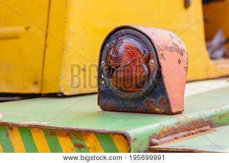 Turn Signal Indicator Of A Old Forklift Truck Closeup