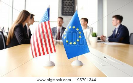 Diversity people talk the international conference partnership. American flag and European Union flag