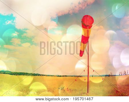 Film Grain. Summer Hot Day On Sport Airport With Abandoned Windsock, Wind Is Blowing And Windsock Is
