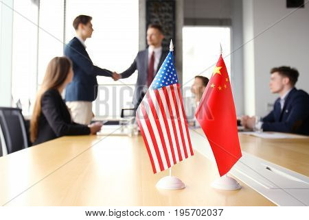 Chinese and American leaders shaking hands on a deal agreement