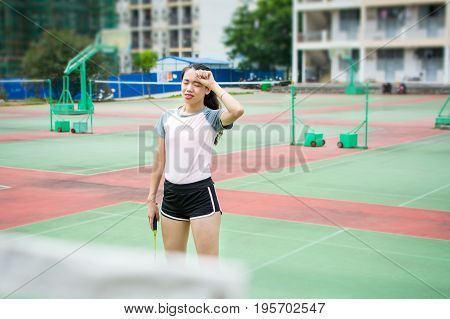 Badminton Player Wiping Sweat On The Court