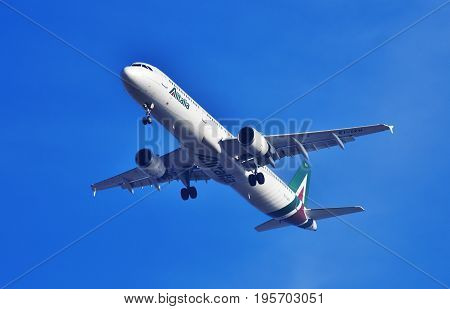 Airplane Of Alitalia Approaching The Airport