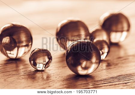 Glass balls of different sizes tinted in gold