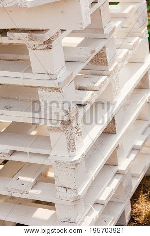 Delivery fabrication wooden fabric concept. Detailed closeup euro pallets made of light wood.