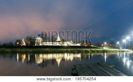 Suzdal, Russia. Nativity Cathedral, the bell tower and Archbishop's chambers of Suzdal Kremlin at night in summer and a wooden pier
