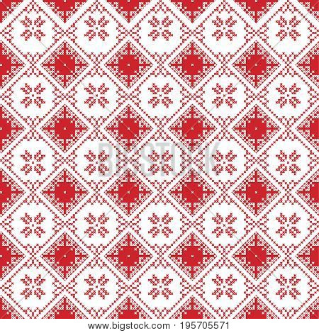 Scandinavian seamless cross stitch inspired by Nordic style Christmas pattern in cross stitch with  snowflake, star and decorative ornaments in red and white in square shape