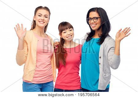 diversity, race, ethnicity, gesture and people concept - international group of happy smiling different women over white waving hands
