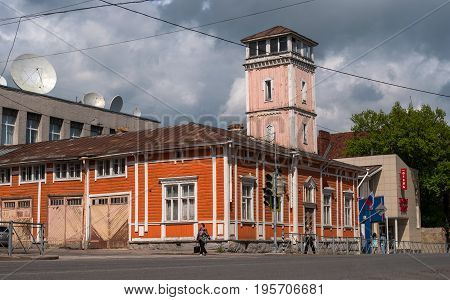 Sortavala, Republic of Karelia, Russia - June 12, 2017: The building of the former fire department. Fire station with a tower was built in 1888. One of the oldest wooden buildings in the city.