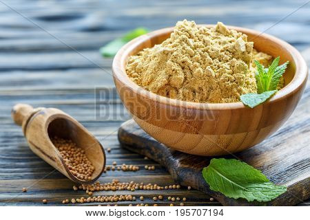 Mustard Powder And Scoop With Mustard Seeds.