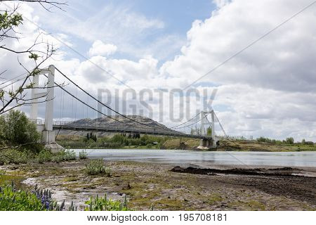 Laugaras Bridge is a suspension bridge and road bridge that was completed in 1958. The river is the river Olfusa