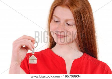 Happy red hair girl hold house key to customers. Isolated on white background. Natural redhaired teenage girl
