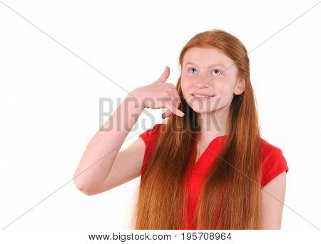 Red hair teenager girl in a red shirt showing a call me sign on white background. Happy smiling lifestyle people concept. Human emotions. Natural redhaired teenage girl.