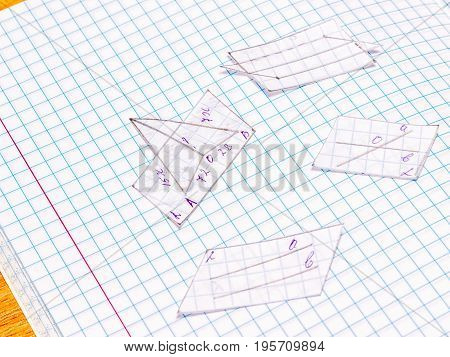 School still life carved geometric shapes on a notebook sheet education key to your success