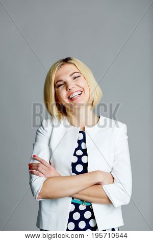 Smiling model with arms crossed