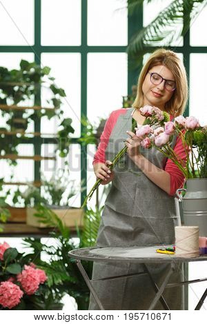Florist with glasses with bouquets