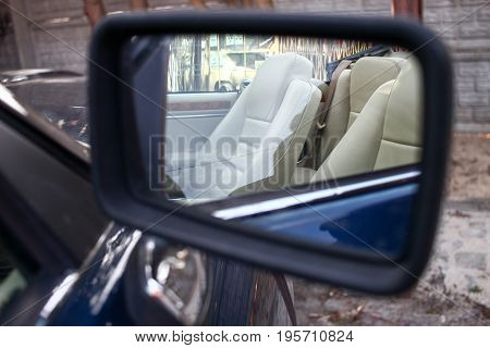 Poland, Otrebusy, 31 March 2017: View In A Mirror Of An Old Car: White Leather Seats