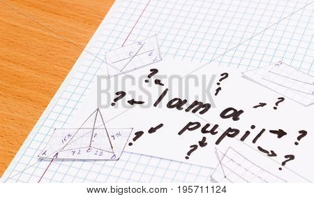 inscription in English is my pupilon a sheet of paper Cut out geometric shapes