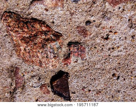A piece of natural granite hit the concrete slab and got a great composition