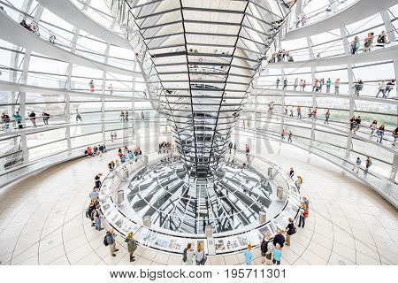 BERLIN, GERMANY - July 06, 2017: Interior view of famous Reichstag Dome with people in Berlin, Germany. It is one of Berlin's most important landmarks