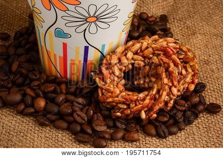 Cup Of Coffee, Biscuits And Coffee Beans On A Wooden Background