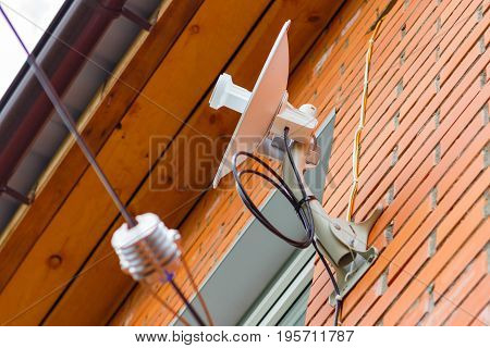Wireless Internet Receiver Antenna On A Brick Wall At Home