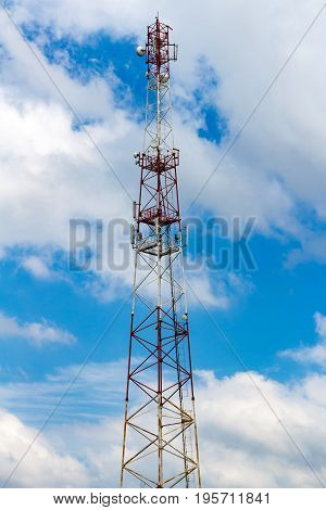 Telecommunication Tower On The Background Of A Cloudy Sky