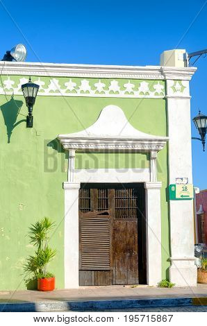 Green colonial house in the corner in Campeche Mexico