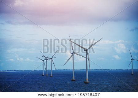 Alternative energy - shot of row of floating wind turbines