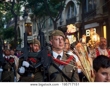 June 19 2017. Spanish soldiers march alongside priests and children during the procession of Corpus Christi. Valencia Spain. Religion and military editorial concept.
