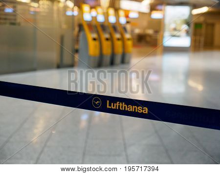 June 23 2017. Close-up detail of a Lufthansa logo on a retractable queue barrier at the check-in counters at Frankfurt Airport Germany. Travel and industry concept.