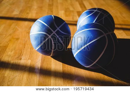 Hgh angle view of blue basketballs on floor in court