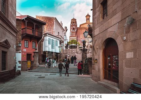 BARCELONA, SPAIN - MAY 2017: Tourists are walking at traditional street of medieval Spanish village at Barcelona town, Catalonia, Spain