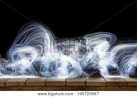 abstract lights on old wood dark background
