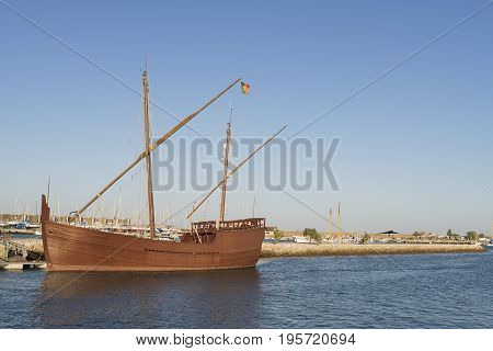 Latin Caravel from the Portuguese discoveries moored in an atlantic ocean port in the south of Portugal