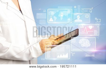 Female doctor holding tablet with blue background and informative graphs and charts