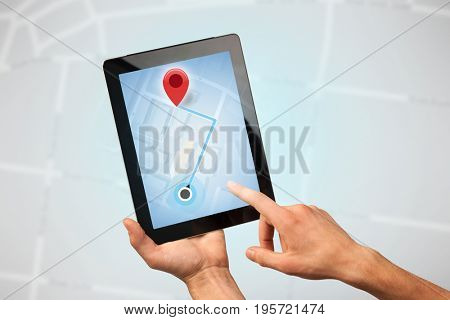 Female fingers touching tablet with map