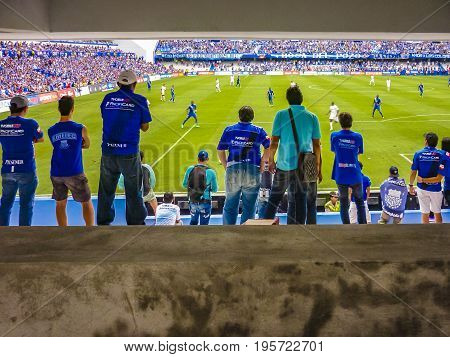 GUAYAQUIL, ECUADOR, NOVEMBER - 2016 - Crowded grandstand at soccer match between Emelec against Liga de Quito playing at the George Capwell Stadium in Guayaquil city, Ecuador.