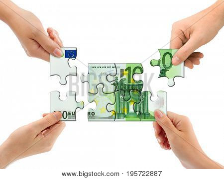 Hands and money puzzle isolated on white background