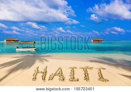 Word Haiti on beach - concept holiday background